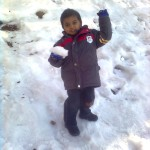 Jasim playing with ice ball 150x150 Mall Road pictures with Jasim and his younger brother Luqman